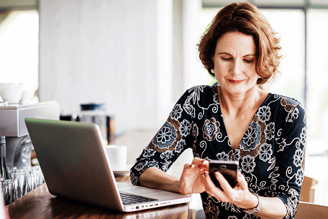 Woman_on_mobile_phone_and_laptop